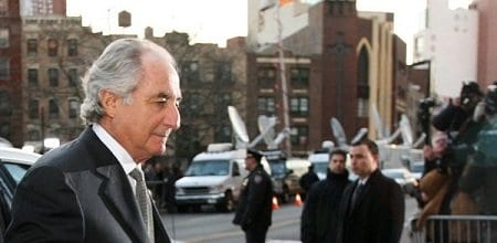 ** CORRECTS FOR SPELLING OF BERNARD ** Bernard Madoff arrives at federal court in New York Thursday, March 12, 2009. Madoff will plead guilty to charges that he engineered one of the largest investment scams in U.S. history and was ready to face a prison sentence of up to 150 years. (AP Photo/Mary Altaffer)